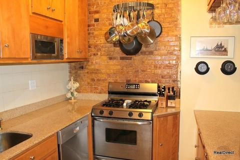 Exposed Brick in Renovated Kitchen
