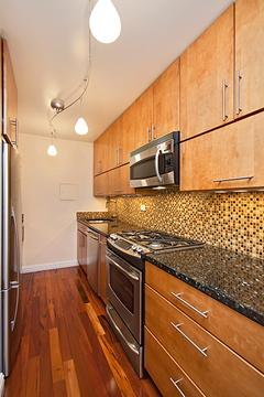 Expanded kitchen.  Solid maple cabinets, granite counters and stainless steel appliances.