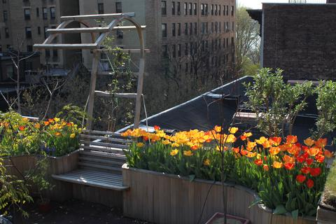The garden has custom planters and seating, and views to Riverside Park and the Hudson River
