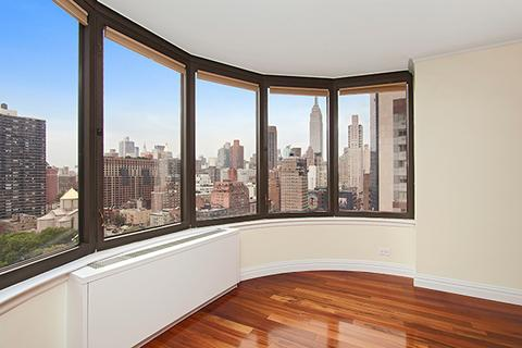 180 degree, south facing windows in living room.  Protected views of Empire State and partial river.