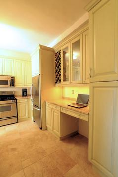 Built-in office area with wine rack and glass display cabinet