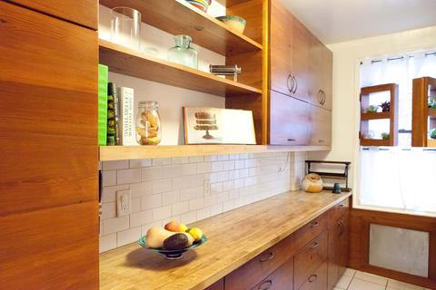 Kitchen has bountiful counter and storage space with unique details