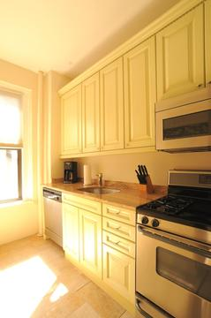 Kitchen with granite counter tops and new KitchenAid refrigerator