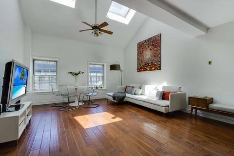 Living/Dining Area with 15+ Foot Cathedral Ceilings and Skylights