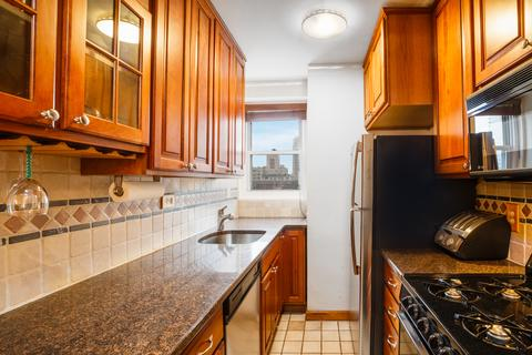 Granite and Stainless Steel Kitchen with all the amenities + a wine rack.