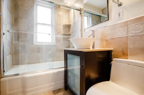 Renovated windowed bathroom with high-end Axor Hansgrohe fixtures