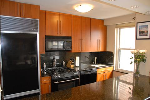 Kitchen with 9-foot granite counter