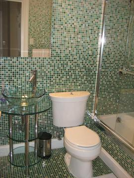 italian glass mosaic tile in fade pattern, glass pedestal sink, crown and base moulding