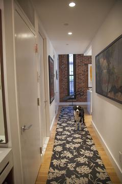 Hallway with a window as its focal-point.