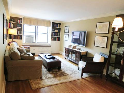 Living Room with built in bookshelves, all TV wires hidden in wall.