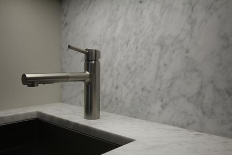 Kitchen. High-quality large and deep stainless steel sink and stainless steel faucet.