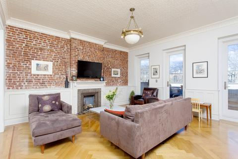 Family Room, with 3 eight-foot doors to the roof terrace, tin ceiling, hidden storage in wainscot.