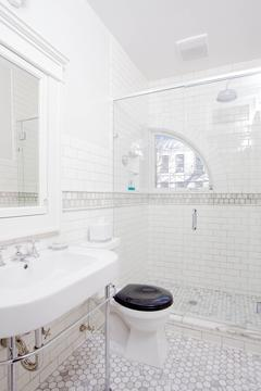 Master Bath: Marble mosaic heated floor, 1/4-round custom window, rain-head shwr, Kallista fixtures