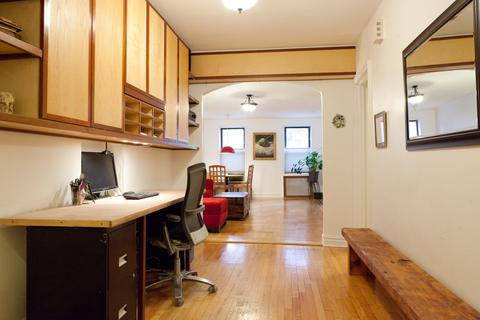 Ample foyer, configured as a home office with built-in cabinets