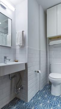 newly remodeled bathroom with custom tilework & high-end fixtures