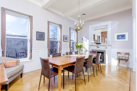 Dining Room- three 7 ft south-facing windows, wainscotting, herringbone floor, 11 foot ceilings