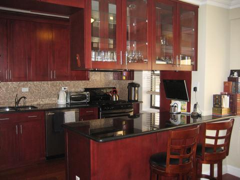 breakfast bar with seating custom cabinets granite countertops stainless steel appliances