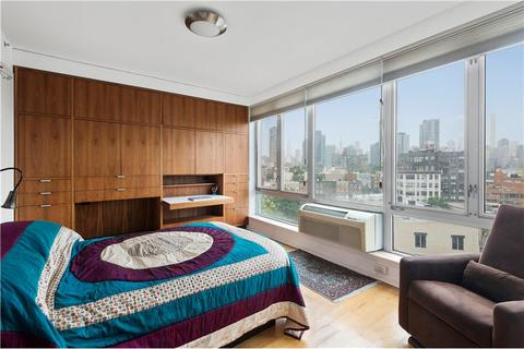 Master bedroom featuring city skyline view