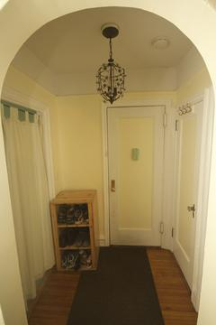 Foyer with two closets, entrance to kitchen on left