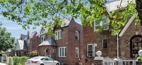 Surrounded by Tudor-style houses on our block