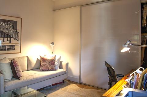 Second Bedroom with huge closet, exposed brick wall; all closets have top quality maple built-ins