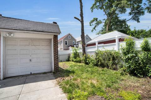 Detached garage and backyard