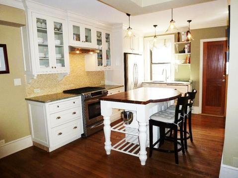 Renovated open kitchen.  Island with walnut top, SS appliances, granite counters.