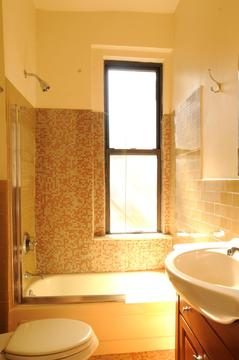 Bathroom with glass tiles