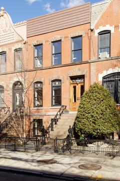 Exterior Front: original Brownstone stoop. New Wood Windows and mahogany entry door.