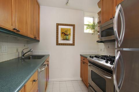 Kitchen with updated appliances and window