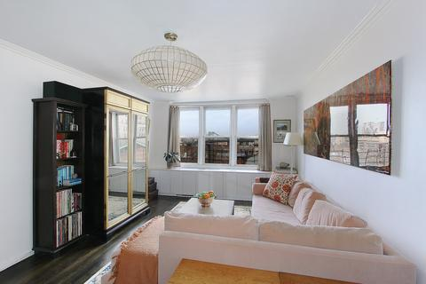 Living room facing north with views of Manhattan