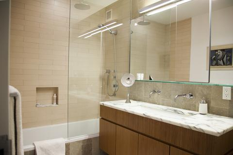 The Master Bath with rain shower, Duravit soak tub, marble counters, limestone flooring, etc.