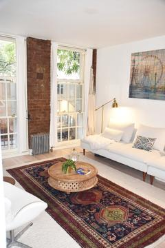Exposed brick in the living room, and both bedrooms