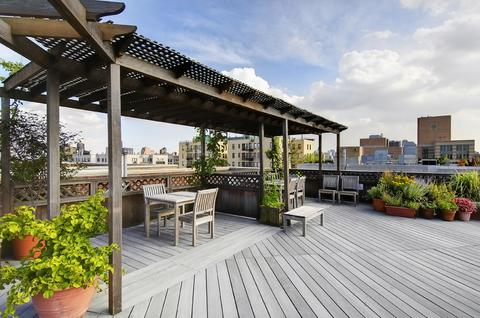 Roof deck's Adirondack seating and trellises for shade