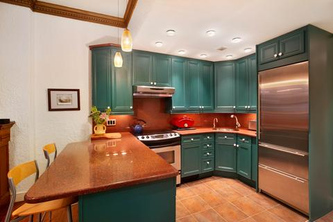 Kitchen with subzero refrigerator and dining island