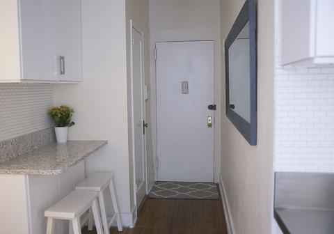 Entry Way and marble countertop eating area
