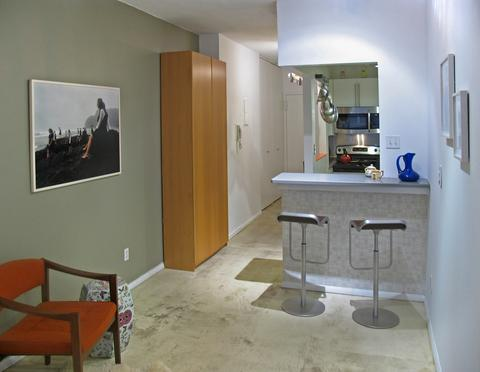 Dining Area and Kitchen beyond (note the designer poured concrete cream colored floors)