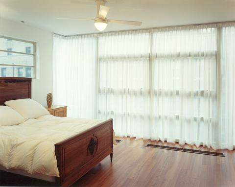 Both bedrooms are flooded with light from floor-to-ceiling windows