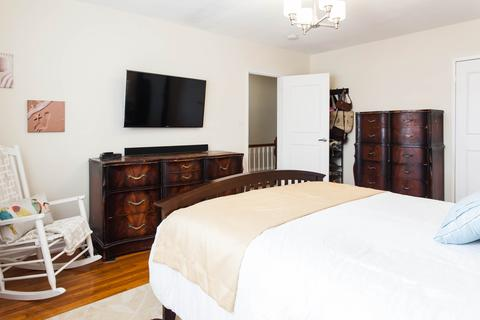 Third Floor: Spacious bedroom 1 with hardwood floors, large closet, plenty of natural light