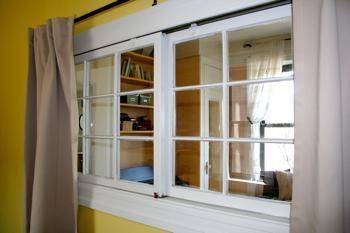 Sliding window between rooms with curtains